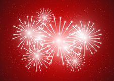 Shiny fireworks on red. Background Royalty Free Stock Image