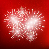 Shiny fireworks on red. Background Stock Image