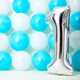 Shiny first birthday. Balloon with blue and white balloons background Royalty Free Stock Photos