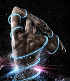 Shiny fitness. Man with perfect fit in shiny background with threads of light stock photo