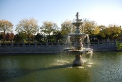 Shiny fountain. A ray of sunlight rightly shine on the fountain Stock Photography
