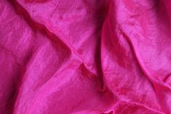 Shiny fuchsia pink silk handkerchief Stock Images