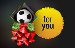 Shiny gift box soccer bal ribbon yellow badge dark background  render Stock Photos