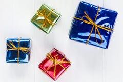 Shiny  gift boxes on white wood background Stock Photography