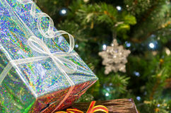 Shiny gifts under the Christmas tree Stock Image