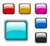 Shiny glass buttons. A set of different colored, shiny glass buttons with 3d effect against white background Royalty Free Stock Image
