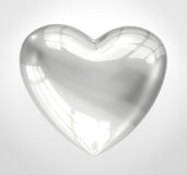Shiny glass heart. Over a gray background Royalty Free Stock Photo