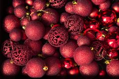 Top view many red christmas tree balls. Shiny and glitter red christmas tree balls decoration, captured from above Stock Photo
