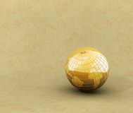 Shiny globe. A shiny golden globe on old paper background Royalty Free Stock Photography
