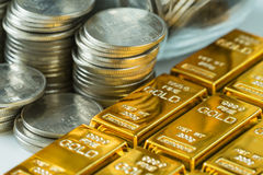 Shiny gold bars with stack of coins as business or financial inv. Estment and wealth concept Royalty Free Stock Photo
