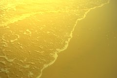 Shiny gold beach texture,abstract background,golden pattern. Shiny gold beach texture ,abstract background ,golden pattern royalty free stock image