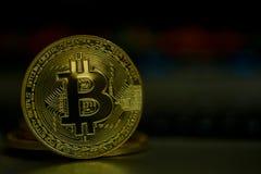Shiny gold bitcoin coin on dark background stock photos