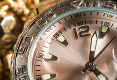 Shiny gold color watch Stock Images
