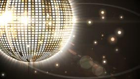 Shiny gold disco ball spinning around Stock Image