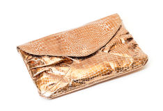 Shiny gold evening bag Royalty Free Stock Images
