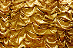 Shiny gold fabric curtain texture background Stock Photos