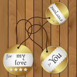 Shiny gold gift round tags for gifts on wooden floor eps10 Royalty Free Stock Images