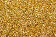 Shiny gold glitter texture Royalty Free Stock Images