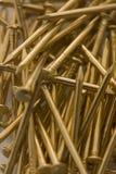 Shiny gold nails Stock Photos