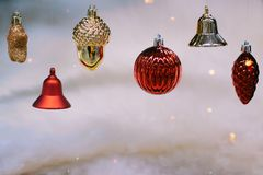 Shiny gold and red christmas balls and bells on retro style for new year royalty free stock images