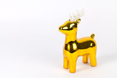 Shiny gold reindeer ornament with copy space, on white Stock Photos