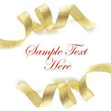 Shiny gold satin ribbon on white background. With copy space Royalty Free Stock Image