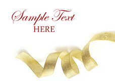 Shiny gold satin ribbon on white background Royalty Free Stock Photos