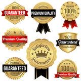 Shiny Gold Seals and Ribbons Stock Images