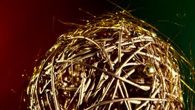 Shiny gold toy for Christmas or New Year, rotation stock footage