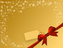 Shiny golden background with red bow in the corner with price tag. Shiny golden background with red bow in the corner and text space with label Stock Image