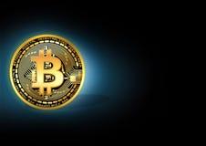 Shiny golden bitcoin stock photo