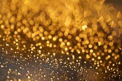 Shiny Golden bokeh on the window Royalty Free Stock Image