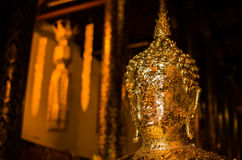 Shiny golden Buddha Stock Image