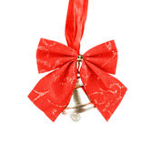 Shiny golden Christmas bell decorated with red bow Stock Photography