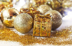 Shiny Golden Christmas Gifts and Balls Stock Image