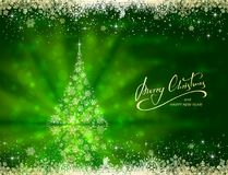 Shiny golden Christmas tree from snowflakes on green background Stock Image