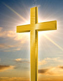 Shiny golden crucifix. An illustration of a shiny golden crucifix, standing tall against the evening sky royalty free illustration