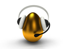 Shiny golden egg with headset  over white Royalty Free Stock Photo