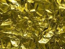 Golden foil texture, grey metallic decorative background. Shiny golden foil texture, grey metallic decorative background Stock Photos