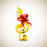Shiny golden g-clef with ribbon. Royalty Free Stock Photography