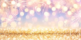 Shiny Golden Glitter With Fireworks royalty free stock images