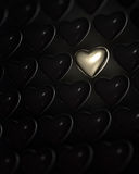 Shiny golden heart surrounded by dark hearts Stock Photos