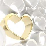 Shiny golden heart among white ones background Royalty Free Stock Image