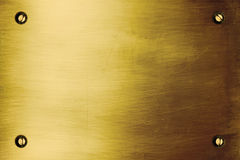 Brushed gold plate Stock Photography