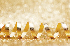 Shiny golden ribbon curls Royalty Free Stock Images