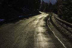 A shiny golden road curve in the Vosges mountains France - hor. A shiny golden road curve in the Vosges mountains France in winter - december 2017 Stock Image