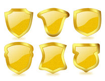 Shiny Golden Shields with Dotted Pattern Royalty Free Stock Images