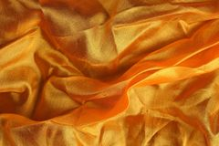Shiny golden silk handkerchief Royalty Free Stock Photos