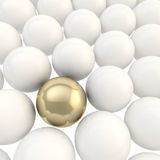 Shiny golden sphere surrounded with white spheres Royalty Free Stock Images