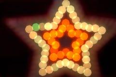 Shiny golden star. The modern bokeh  background Royalty Free Stock Photos